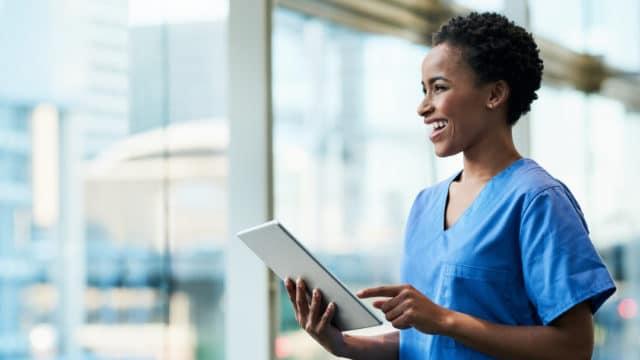 Medical practitioner using a digital tablet in a hospital